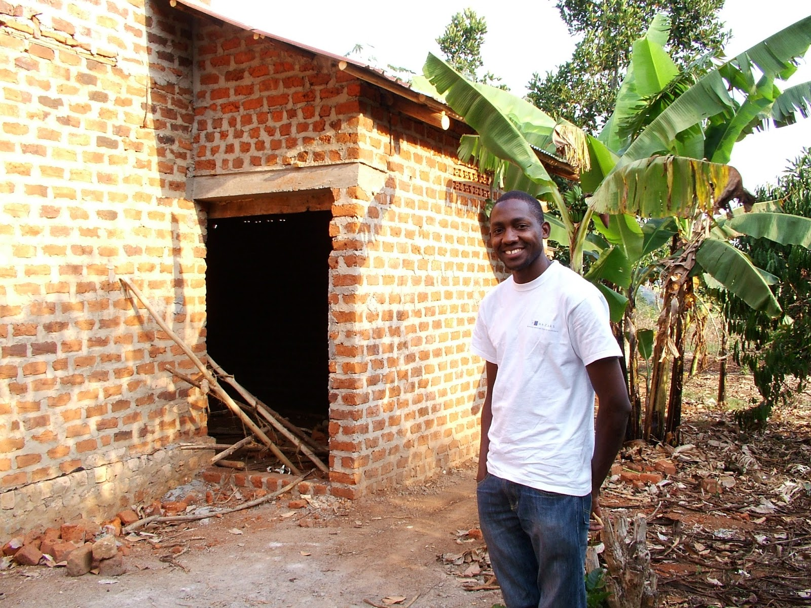 Fellow Charles Batte and the village library he is constructing in Katiiti Village, Mpigi District